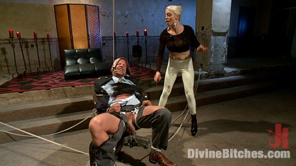Muscular slave is in bondage and at the edge of having heart attack because mistress is riding him (and his cock) in kinky poses