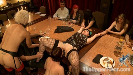 Community dinner correcting o and debauching siouxie. After several unfortunate mistakes, o is bent over the table and spanked. The Steward places her face between Siouxies legs and demands that she pleas