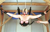 Suspension bondage with tit torture.