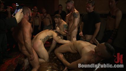 A handsome hunk gets ganged up by 100 lusty men during folsom weekend. 100 exciting men use and abuse a handsome hunk at a party.