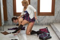 Lea Lexis punishes her co-ed friend be the girls bathroom with hot spanking, tit torture and hard strap-on sex.