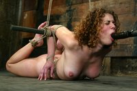 Cute girl Hogtied, caned, and made to cum.