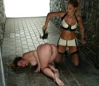 Hollie is spanked and whipped while bound to a wall.