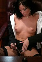 Naughty Nadia gets machine fucked in her corporate office.