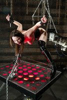Dana DeArmond is gagged and bound while the machines make her cum