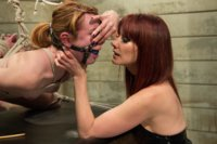 Cute redhead dominated by fierce redheaded lesbian dominatrix whipping her to orgasm with the sybian and strap-on fucking her ass deep.