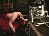 Lovely red-head gets tied up and machine fucked.