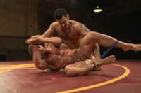 Jeremy Stevens and Marcus Ruhl are oiled down as they fight for sexual dominancy