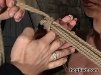 Hottie tied up in an exotic suspension scene. Rope bondage tutorial