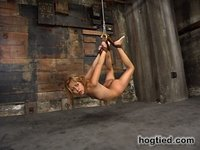 Incredible hottie tied into impossible postures.