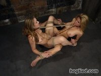 Erotic bondage scenes with two beautiful women.