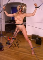 Beautiful girl tied up on a cold steel rack.