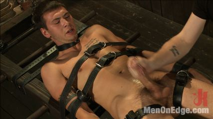 9 inch penish edged in metal bondage. Hot jock Jay Cloud's 9 inch dick relentlessly edged as he's bound for the first time