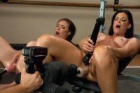 MILF cougar attacks a hot girls pussy and ass with machines unitl she squirts. They both cum rivers from machine fucking hotness.