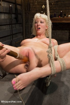 Cherry Torn is spanked, caned and is hungry for wet pussy when Felony punishes and strap-on fuck both her ass and cunt.