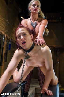 Cheyenne Jewel dominated by statuesque blonde dominatrix, Phoenix Marie while chained to floor and strap-on fucked in the ass.