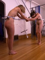 Two girls tied together.
