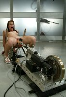 Sarah Blake returns for a restrained, big dildo machine shagging.