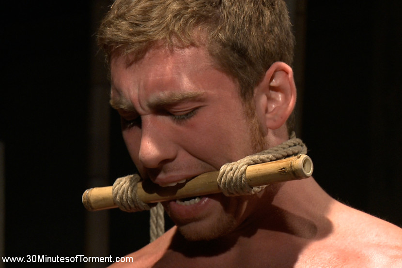 House dom connor maguire extreme molested and butt violation. House Dom Connor Maguire finally steps up to the 30 Minutes of tortured challenge. The Bamboo Garden - Connor starts things off brutally, tied to bamboo chutes. Van works the muscled studs chest with some mbacksideive punches before caning his backside. With his cock mbacksideive, and tied up Connor endures more caning and nipple anguished. The Pit - Strapped up with belts and balancing on pegs, Connor takes the flogging of his life as Van wields two floggers. We've seen him dish it out but the hunk can really take a beating too. With a dildo mounted on the platform, Connor squats on to it, enduring the backside anguished as well as the stress position with another round of mbacksideive flogging mixed in. The Water Station - With Connor's entire torso feeling the agonizing pinch of the numerous clothes pins we hit him mbacksideive with the water. Each clothes pin is held by twine causing it to pull on the stud's flesh whenever he tries to avoid the intense spray. After a round of breath play Connor has gotten through his 30 minutes and cums mbacksideive after the day's session.
