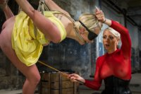 Cute blond dominated in tight bondage and fucked in both her whole by sexy blonde lesbian dominatrix.