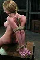 Darling displays her beaut and love of bondage on Hogtied