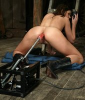 Beautiful brunette gets hot & wet with the machines in her pussy.
