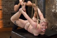 Suspended Anal Invasion for bound blonde beauty Ella Nova! Back breaking hogtie pummels her pretty pussy into uncontrollable orgasms. Creamy thighs sp