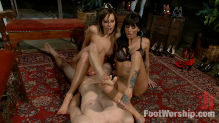 Male is suffering pain and pleasure from the two trampling ladies