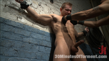 Alex adams endures the penish balls and anus tormented. Muscled stud Alex Adams endures the wall, the pit and the water chamber before finally blowing his hot load