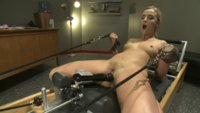 Sexy, toned blond with athlete build and tight pussy gets fucked by machines until she squirts all over the coach's office!