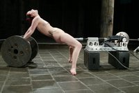 Kinky and flexible dancer does the splits for the machines.