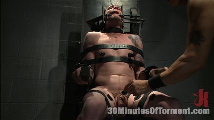 Stud with a 10 inch fat cock gets tortured to the extreme. Jay Rising with a 10 inch fat penish gets tortured and made to cum.