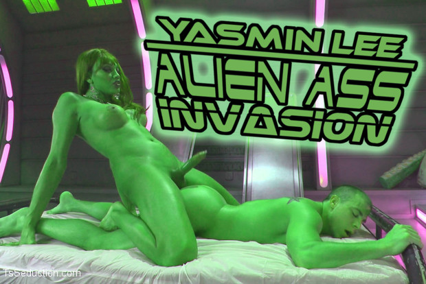 Yasmin seduces, examines & uses up Eli in this alien sci-fi medical themed shoot. Her massive cock explores the great black hole of his ass & mouth!