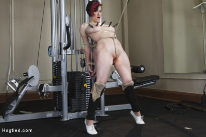 Iona Grace big natural tits tied up in the exercise room, legs spread with, tight crotch rope, pussy penetrated and vibrated