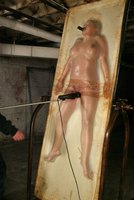 Candy Manson gets roped, caned, flogged, and oiled up
