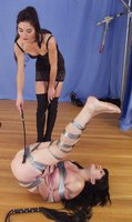 Carly gets harsh treatment from visiting dominatrix Rebecca Lords