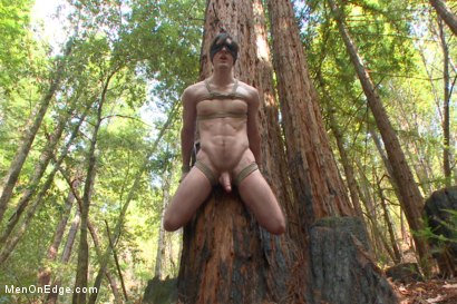 Naked Stud Gets Tied Up To A Tree
