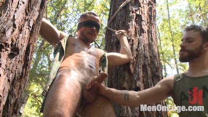 Russian soldier captured and edged deep in the woods. Russian soldier Valentin Petrov gets captured and edged deep in the woods