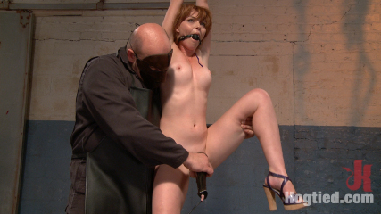 Dirty redhead slut scrubbed clean. Hot redhead slut Marie McCray bound tight, suspended hogtie, hanging wrist bondage, hosed off and orgasmed