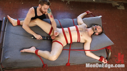 Rugby stud gets edged. Rugby stud Nathan Martin gets tied up, backside dildoed and edged