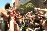 Bound-hunk-publicly-tormented-and-gang-fucked-for-his-first-Dore-Alley