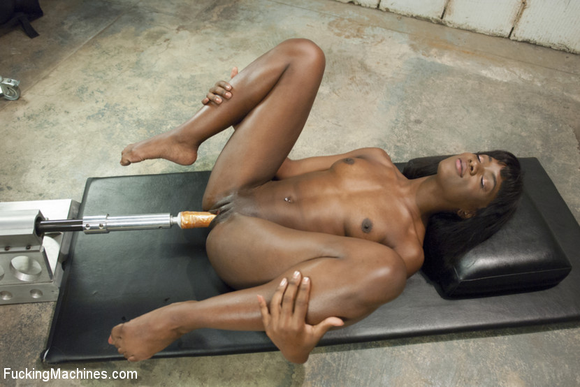 image Ebony fucked and squirted by automatic plastic cock