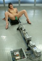 Covered in oil and pussy wet, Satine gets it on with the machines