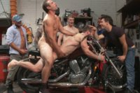 Ripped mechanic gets taken down in his own garage and fucked by a horny crowd of men