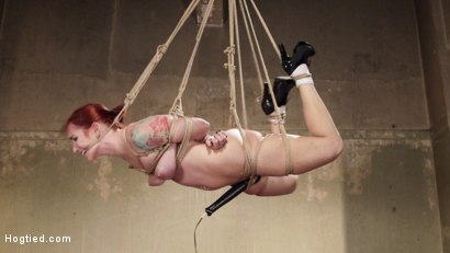 Beautiful all natural redhead is taken down and tied tight in brutal rope bondage