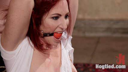 Redhead take down. Beautiful all natural redhead is taken down and tied tight in brutal rope bondage