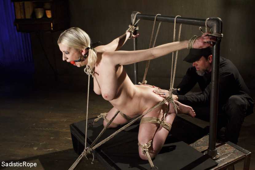 Methodical madness. Cherry begins in a predicament position that is stressing her body in all of the right ways. Her knees are taking the brunt of her weight, her arms stretched back, and then a crotch rope is added to pull this helpless slut into a grueling stress position. Her feet are tortured mercilessly as she screams and begs for it to stop.Next we have Cherry on her back, legs spread and her feet are again exposed and available. The Pope goes to work on her feet with every trick he has, trying to destroy this helpless slut. Her nipples get the full treatment as well with clamps pulling in every direction.The last scene was designed to put Cherry's slutty ass in the air for The Pope to have his way with. She is slap and flogged, and then she gets a taste of extreme pain that only a sick fuck could dish out.