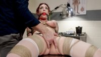 Dahlia is our sexy nurse who is bound and tormented by one of her patients.