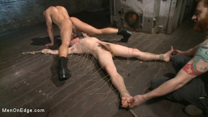 Suspended-in-a-center-split-helpless-uncut-stud-blows-a-huge-load