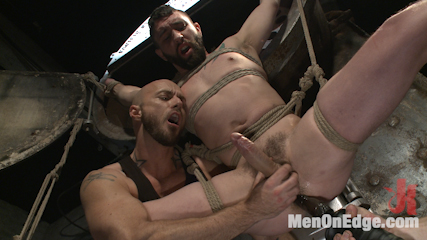 Suspended in a center split, helpless uncut stud blows a huge load!